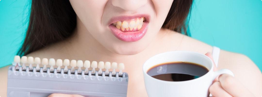 Причины черных зубов